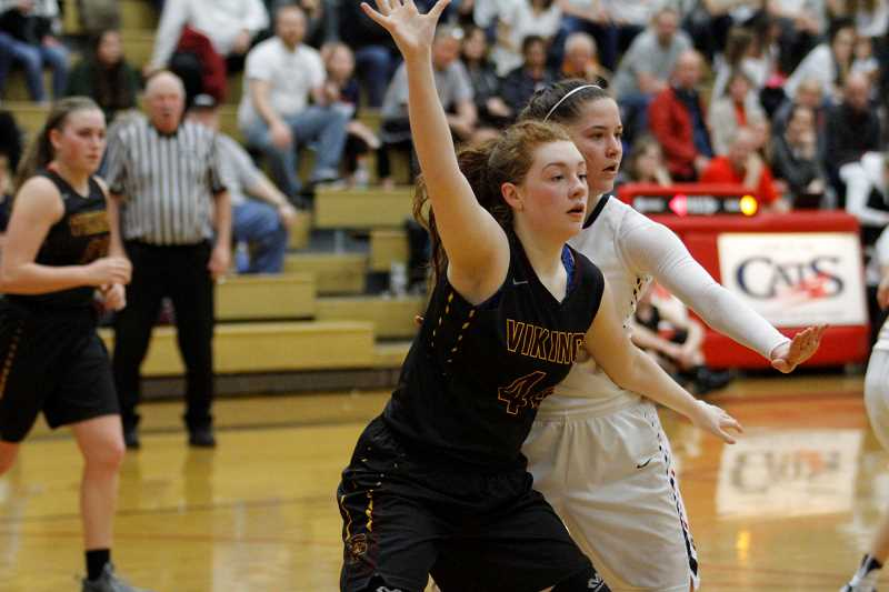 NEWS-TIMES PHOTO: WADE EVANSON - Forest Grove's Olivia Grosse posts up during the Vikings' playoff game against Westview last season.