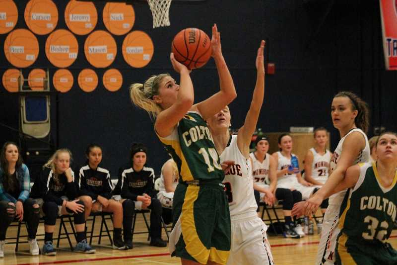 PIONEER PHOTO: CONNER WILLIAMS - Colton senior Grace James (10) takes a shot during the Lady Viks' 65-31 loss to Monroe last season.
