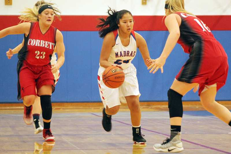 WILL DENNER/MADRAS PIONEER - Although lacking seniors last year, the Madras will benefit from it this season, as its entire roster returns to the fold, including all-league player Jiana Smith-Francis (24).