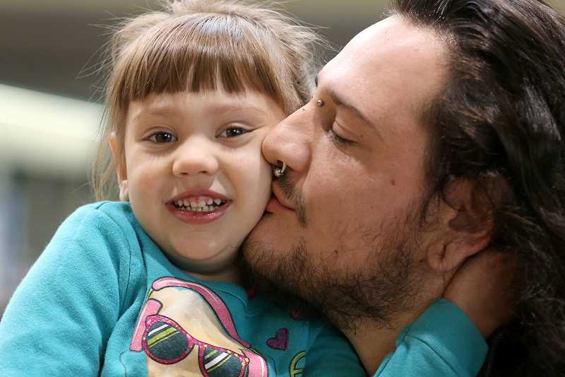 COURTESY: PCC - PCC student Jeff Martinez, pictured with his daughter, is able to attend school because of PCC's childcare subsidy program. A new grant will allow PCC to continue the program.