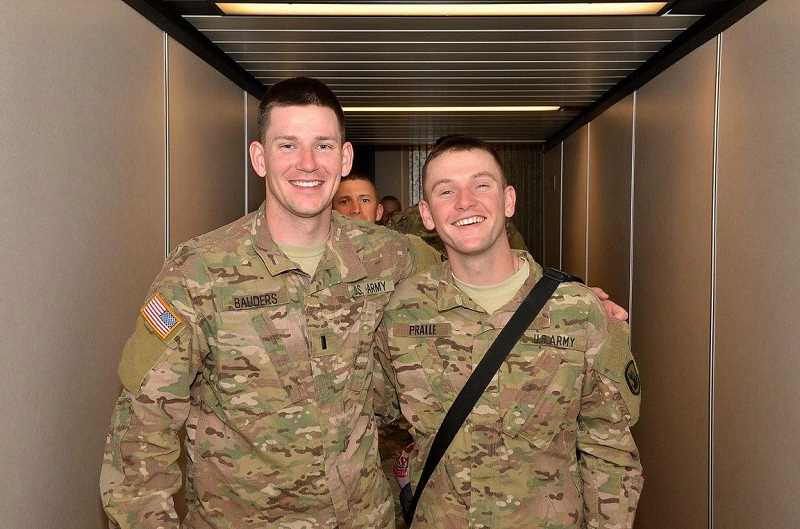 COURTESY PHOTO - Bauders (left) posed with fellow soldier Benjamin Pralle, who later posted the photo on Facebook along with a message that said, 'Never had to deal with a loss like this before. It was the hardest part of the deployment.'