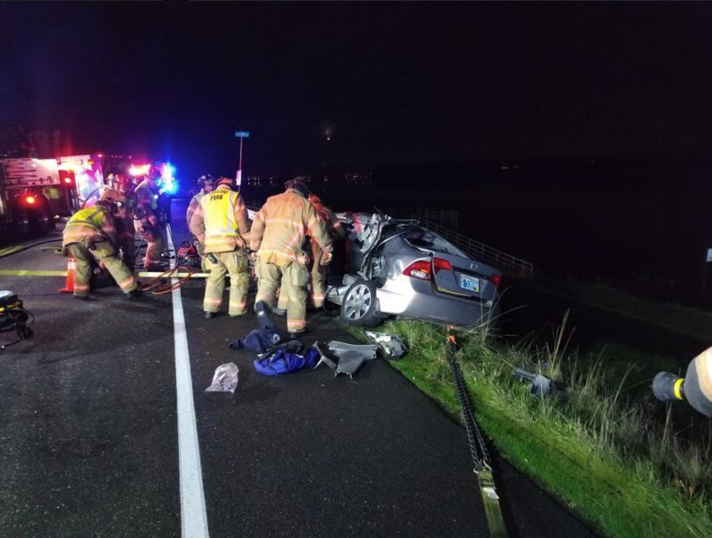 KOIN 6 NEWS PHOTO - First responders work to free a person after a semi truck collided with a sedan on Wednesday, Nov. 29.