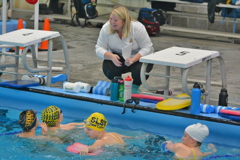 SPOTLIGHT PHOTO: JAKE MCNEAL - Lions coach Chelsie Orr chats with Olea Opdahl, Audra Lein, Maggie Wheeldon and Maddie Watt.