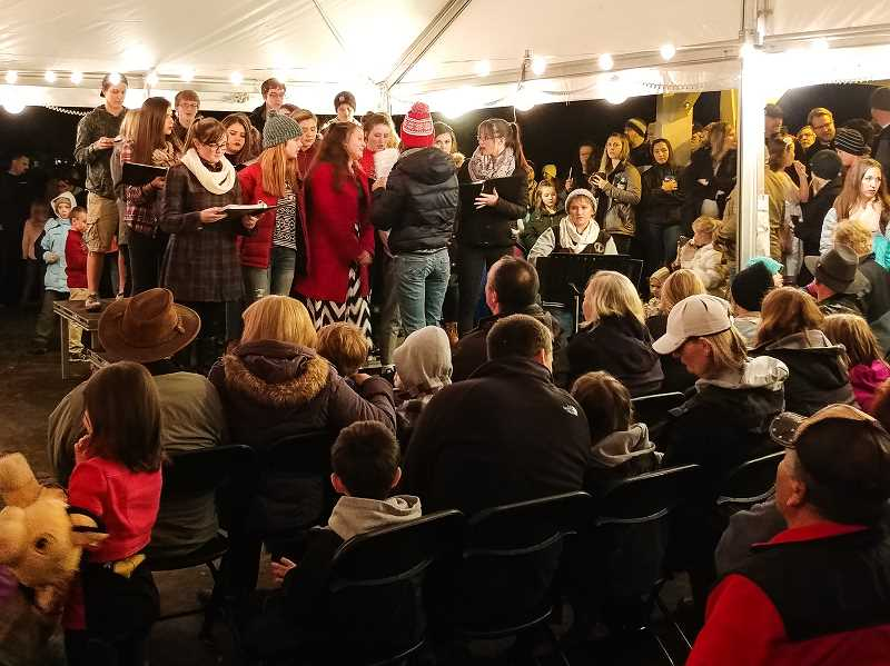 NEWS-TIMES PHOTOS: CHRISTOPHER OERTELL - Banks residents came out to listen to the Banks High School choir during the city's Christmas tree lighting ceremony at Greenville City Park on Sunday, Nov. 26.