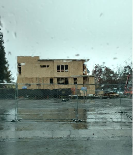 PAMPLIN MEDIA GROUP: JULES ROGERS - The building shown under construction behind the empty food cart site is at the address 2530, and replaces a 1901 single-family home. Its owned by 28th Place Condos, an LLC with the same listed business address as Everett Custom Homes.