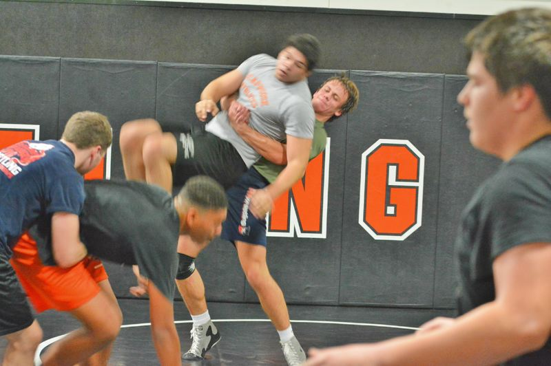 SPOTLIGHT PHOTO: JAKE MCNEAL - Jack Eggers, center, will compete for his third Class 4A State Championships appearance.