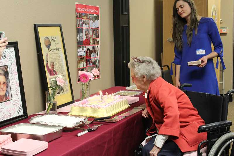 HERALD PHOTO: KRISTEN WOHLERS - Grace Burnham blows out the candles for her 105th birthday celebration on Nov. 18.