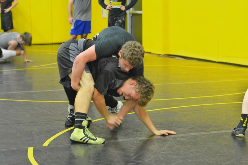 SPOTLIGHT PHOTO: JAKE MCNEAL - Junior Sean Lee resists a takedown from freshman Mavrick Rask in practice Tuesday, Nov. 21, at St. Helens High School.