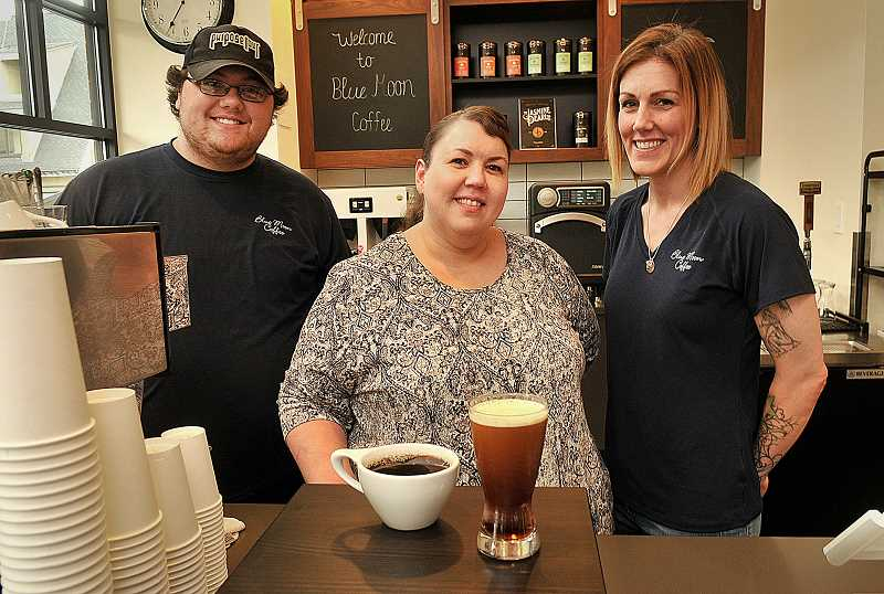 REVIEW PHOTO: VERN UYETAKE - Staff member Dakoda Archer, owner Julia Fowler and team leader Nikole Weir stand behind the counter at Blue Moon Coffee's new location in downtown Lake Oswego.
