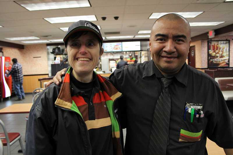 REVIEW PHOTO: SAM STITES - Amy Hannum and General Manager Tony Jimenez pose for a photo at the Burger King on McEwan Road. Hannum recently marked 30 years of working at the restaurant.