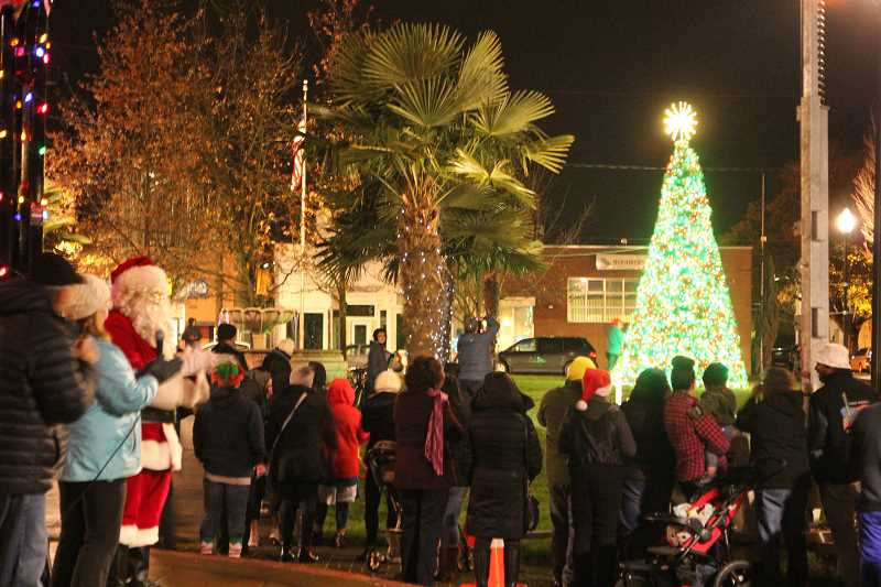 INDEPENDENT FILE PHOTO - Last year's tree lighting in the Woodburn Downtown Plaza included a visit from Santa.
