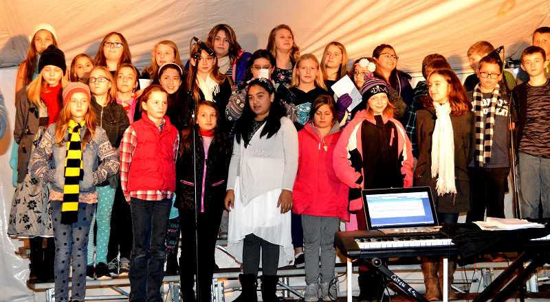 PIONEER FILE PHOTO - Last year, Colton's fifth grade chorus performed under the tent at the annual ColtonTel tree lighting.