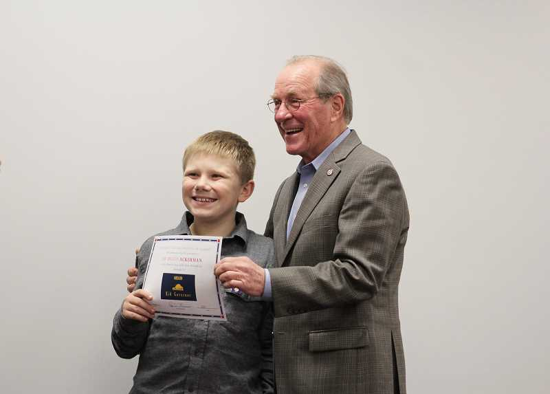 HERALD PHOTO: KRISTEN WOHLERS - Ted Kulongoski presents a certificate to Brady Ackerman, Carus's nominee for kid governor, who went on to be in the top eight in the state of Oregona as a candidate to become Oregon's Kid Governor.