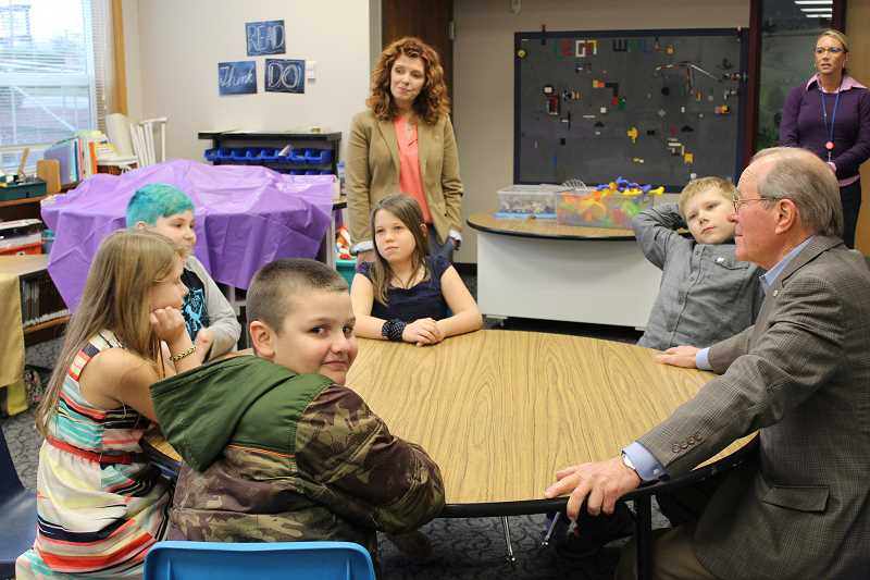 HERALD PHOTO: KRISTEN WOHLERS - On Nov. 30, former Governor of Oregon Ted Kulongoski visits with the Carus fifth grade students who ran for kid governor.