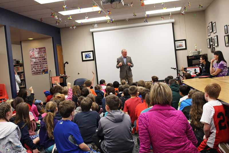 HERALD PHOTO: KRISTEN WOHLERS - On Nov. 30, former Governor of Oregon Ted Kulongoski visits with all of Carus's fifth grade classes, who voted to nominate a candidate for kid governor.