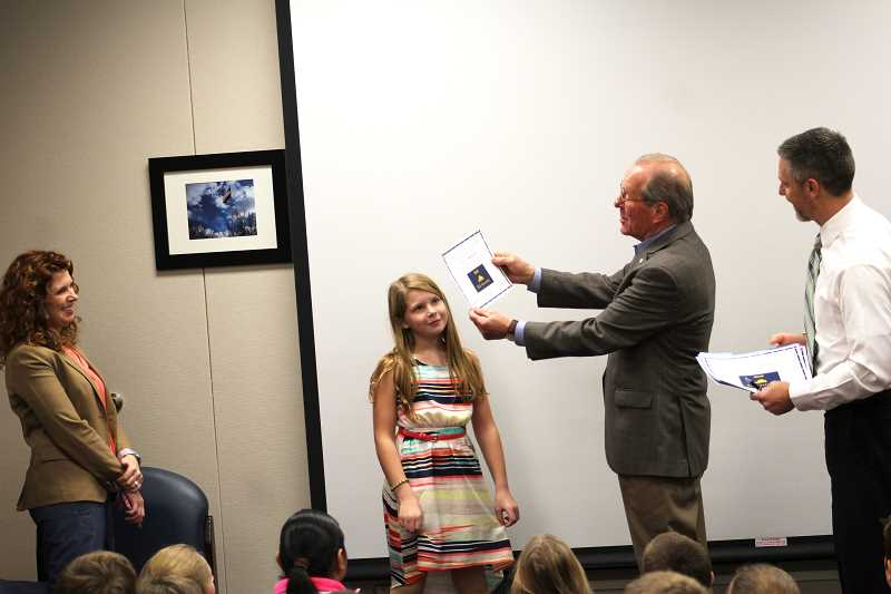 HERALD PHOTO: KRISTEN WOHLERS - Ted Kulongoski presents a certificate to Ava Drazan, who ran for kid governor.