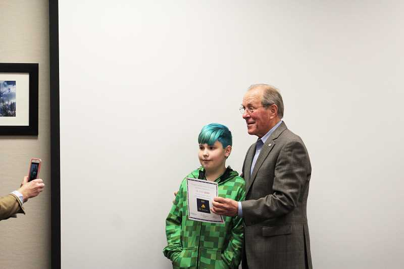 HERALD PHOTO: KRISTEN WOHLERS - Ted Kulongoski presents a certificate to Korin Adams, who ran for kid governor.