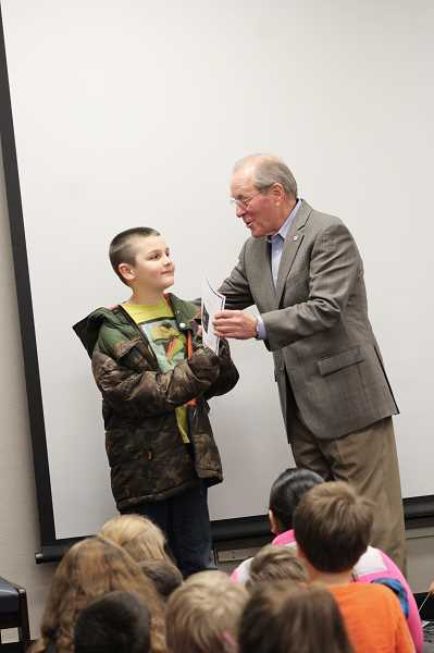 HERALD PHOTO: KRISTEN WOHLERS - Ted Kulongoski presents a certificate to Zac Pitkin, who ran for kid governor.