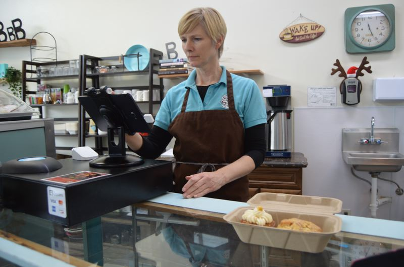 SPOTLIGHT PHOTO: NICOLE THILL - Darcy Potter McDonald, owner of Brown Butter Bakery in Scappoose, helps a customer at her store. While the bakery was not open on Small Business Saturday, McDonald said she has seen traffic in the store slowly start to increase heading into the holiday season.