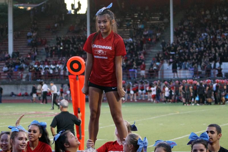 CONTRIBUTED PHOTO - Vy Nguyen, is a flyer on the Centennial cheer squad and is thrown in the air and executes complex stunts as part of the team.