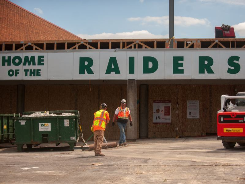 FILE PHOTO - Construction workers are undertaking a major remodel and building additions at Reynolds High.