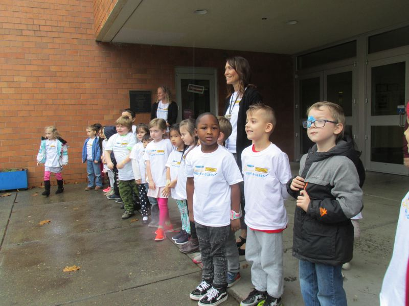 OUTLOOK PHOTO: TERESA CARSON - A kindergarten class from Hollydale Elementary School lines up for the arrival of a semi truck cab loaded with school supplies for their classroom.