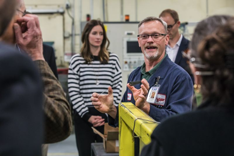 TIMES PHOTO: JONATHAN HOUSE - Kershaw factory manager Mark Bochsler talks about the knife-making process during a tour for elected officials.