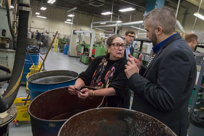 TIMES PHOTO: JONATHAN HOUSE - Oregon State Sen. Betsy Johnson asks questions about the knife-making process during a tour of Kai USA's factory in Tualatin.