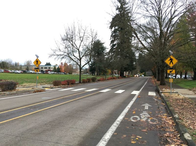 COURTESY OF THE CITY OF TUALATIN - A striped crosswalk with flashing beacons indicating when pedestrians are crossing has been installed on Leveton Drive in Tualatin.