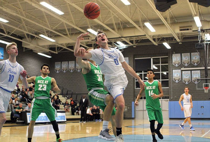 REVIEW PHOTO: MILES VANCE - Lakeridge's Matt Armsby gets fouled on the way to the basket during his team's 90-81 loss to McKay at Lakeridge High School on Friday.