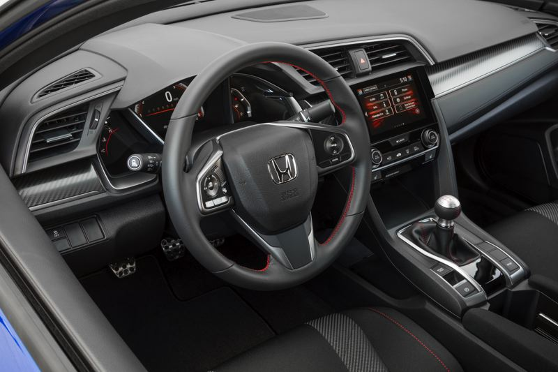 HONDA NORTH AMERICA - The interior of the 2017 Honda Civic Si includes special trim. A six-speed manual is the only transmission.