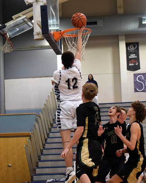 SPOKESMAN PHOTO: TANNER RUSS - Sophomore Dakota Reber had several huge dunks this past weekend that energized the home crowd and were emphatic statements in the Wildcats three victories in the Wilsonville Invitational Tournament.