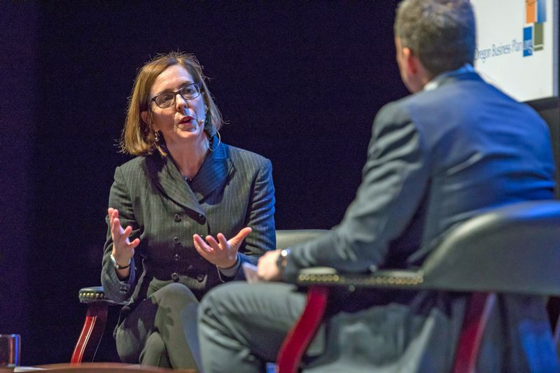 TRIBUNE PHOTO: JONATHAN HOUSE - Gov. Kate Brown, being interviewed by Patrick Criteser, speaks Monday, Dec. 4, at the Oregon Leadership Summit.