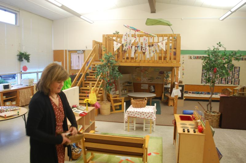 PHOTO BY: RAYMOND RENDLEMAN - Marylhurst School teacher Pat Lammers teaches 4-year-olds who love to climb an indoor playstructure in her classroom.