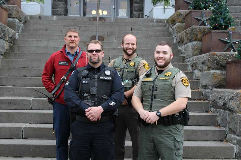 HOLLY SCHOLZ - The No-Shave November contest winners left to right, firefighter/paramedic Chris Bocchi from Crook County Fire and Rescue, Sgt. Troy Wiles from the Prineville Police Department, Det. Mitch Madden from the Crook County Sheriff's Office, and Corrections Deputy Anthony Redden-Pickett from Crook County Corrections. Not pictured was firefighter/paramedic Sam Scheideman from Crook County Fire and Rescue.