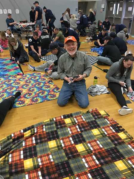 Dr. John Zieg helps put together a blanket during Saturday's Operation Snuggle event at Baker Prairie Middle School.