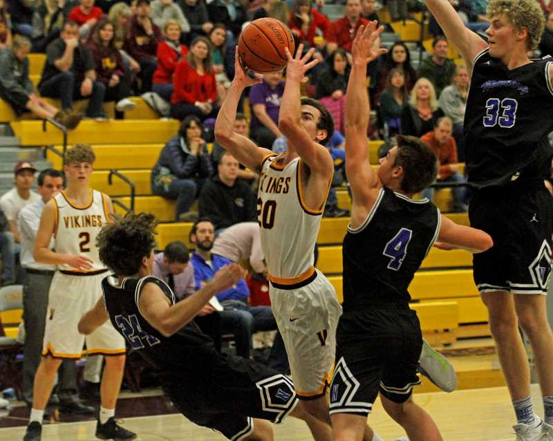 NEWS-TIMES PHOTO: WADE EVANSON - Forest Grove's Kyle Thompson goes up for a shot in the lane among a swarm of Newberg defenders during the Vikings' game Dec. 1 at FGHS.