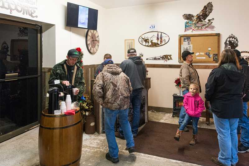 NEWS-TIMES PHOTO: CHRISTOPHER OERTELL - Brady Sheets held a grand opening Saturday for his new business, Western Ironworks, along with a fundraiser for a Yamhill man. Customers browsed and placed Christmas orders.