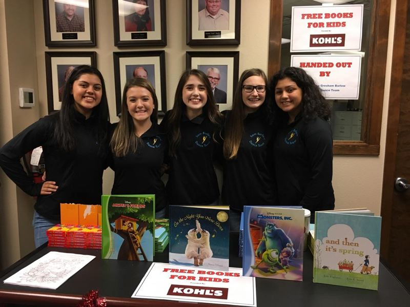 CONTRIBUTED: GREG DIRKS - Members of the Sam Barlow High Dance Team distributed free books provided by Kohl's on Saturday, Dec. 2.