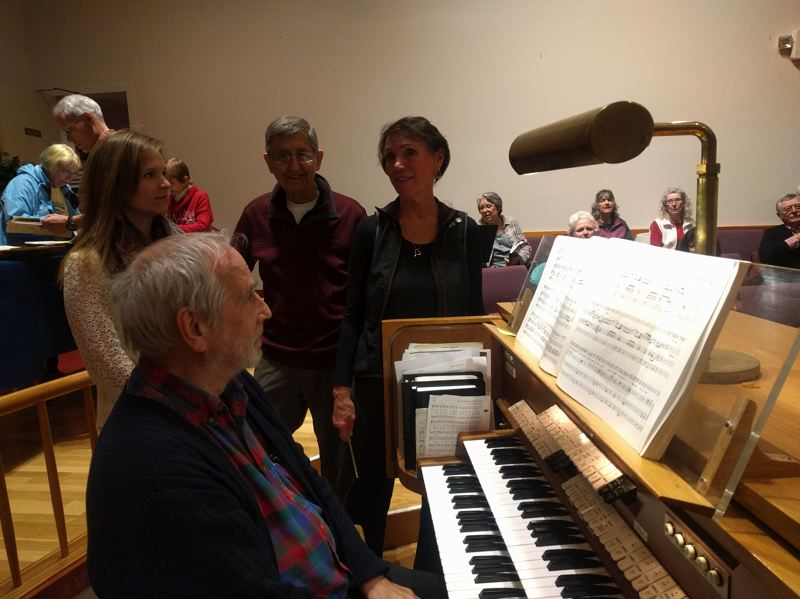 NEWS-TIMES/HILLSBORO TRIBUNE PHOTO: MICHAEL SPROLES - Joannah Ball, Michael Fox, Paul Minor and Laura Frye huddle up before a rehearsal for Messiah begins.