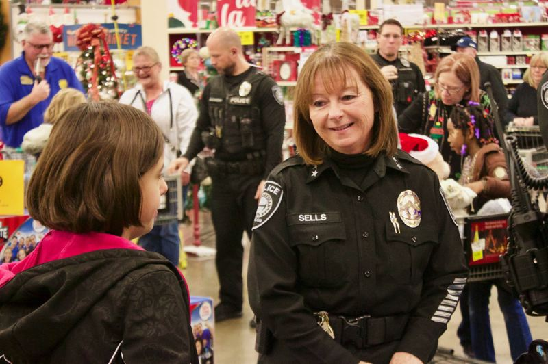 OUTLOOK PHOTO: CHRISTOPHER KEIZUR - Gresham Police Chief Robin Sells likes participating in Shop with a Cop because it allows her officers to connect with children in a positive manner.