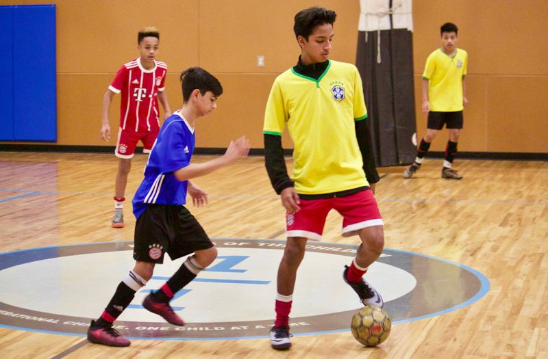 OUTLOOK PHOTO: CHRISTOPHER KEIZUR - Local youths have a safe place to play indoor soccer thanks to a partnership between the city of Gresham and Friends of the Children.