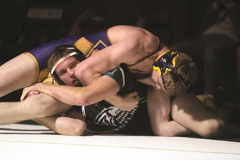 PHIL HAWKINS - North Marion senior Alec Roberts works from the bottom in a 13-5 major decision victory over Canby's Michael Clark on Nov. 29.