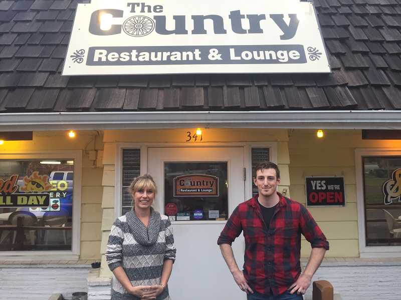 ESTACADA NEWS PHOTO: EMILY LINDSTRAND - Sherry and Cam Andrus are the new owners of the Country Restaurant. After a remodel at the beginning of next year, the establishment will reopen as Mickey B's on Main.