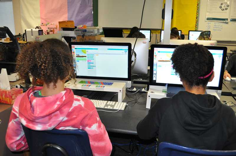 TIMES PHOTO: BLAIR STENVICK - Fowler Middle School sixth-graders Jaida Brandon and Raisina Triplett work on coding lessons in Jo Barendse's classroom.