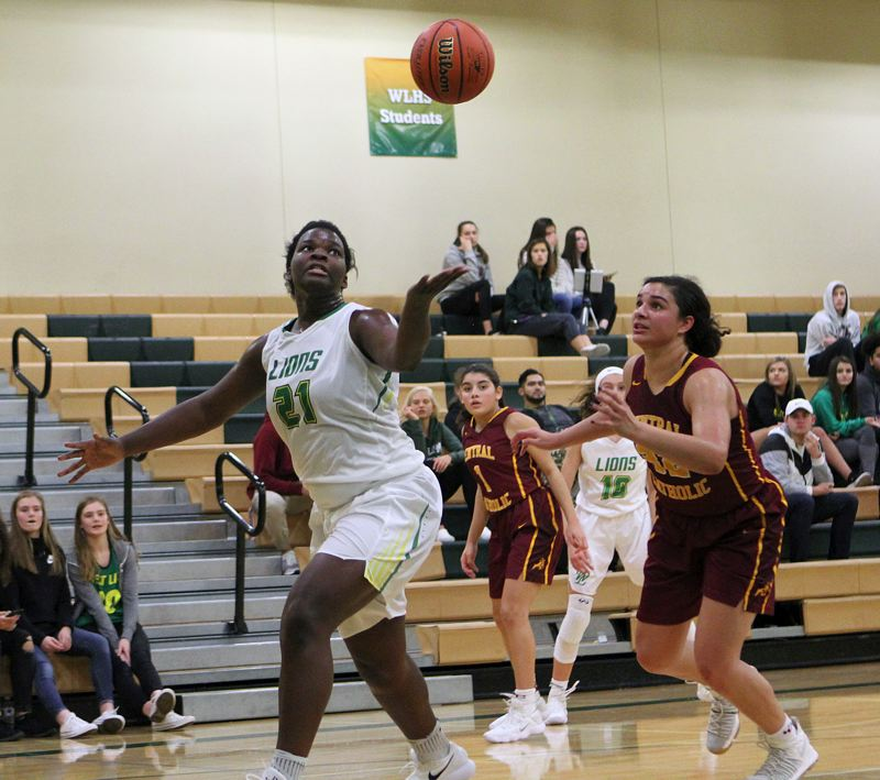 TIDINGS PHOTO: MILES VANCE - West Linn freshman Aaronette Vonleh tries to grab a loose ball during her team's 73-71 overtime win against Central Catholic at West Linn High School on Tuesday.
