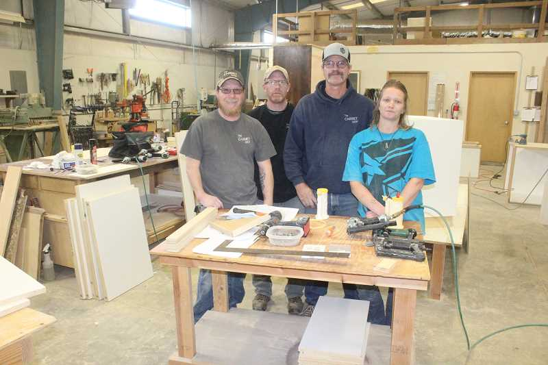 SUSAN MATHENY/MADRAS PIONEER - Taking a quick break from work at The Cabinet Shop are, from left, Dennis Hill, Alan Waldow, owner Lance Handsaker and Carmen Handsaker.