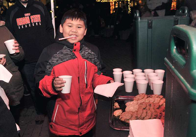 VERN UYETAKE - Leeland Aldan was excited to get some hot chocolate and a cookie.