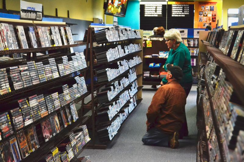 POST PHOTO: BRITTANY ALLEN - Several Sandyites are getting their last Blockbuster movie nights in while they still can.