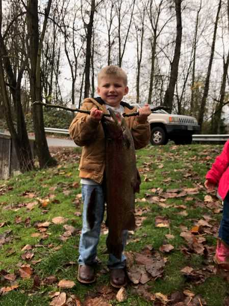PHOTO COURTESY OF LAURA GREEN - Eli Gorton-Green reeled in this monster trout at the Canby Pond on Sunday, Dec. 3.